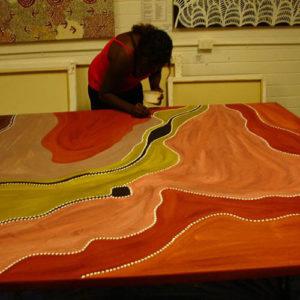 Charlene painting a monster Aboriginal Artwork