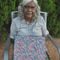 "Rosemary was one of a group of Anmatyerre women at the forefront of the art movement in the Utopia area. She was amongst a small group of women who travelled to Indonesia to learn various techniques in the manufacturing of batiks. It was after the ""summer project"" sponsored by the CAAMA network in 1998 that Rosemary spread her wings and started painting with acrylics and canvas. As a bush woman, she is familiar with her land and its abundance of bush tucker species, medicine plants and native fauna. The stories related to the bush tucker have been inherited by her, along with important women's stories and form the basis of her paintings. She is a highly talented artist whose works are sought after by collectors worldwide. Selected Collections • Holmes a' Court Collection, Perth Selected Exhibitions 1989 • Utopia Women's Paintings 'A Summer Project' 1990 • 'A Picture Story', 88 silk works from the Holmes a'Court Collection, UK 1993 • Central Australian Aboriginal Art & Craft Exhibition, Alice Springs 1996 • ""The Meeting Place"", - touring exhibition, Australia • ""Nangara"", Stitching Sint-Jan, Brugge, The Netherlands 1998 • Dacou Gallery, Australia 2008 • Black & White: Inspired by Landscapes, Kate Owen Gallery, Sydney • Central Art Christmas Exhibition, Alice Springs 2009 • Central Art Mid Year Exhibition, Alice Springs"